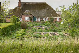 Thatched house with garden (East Frisia, northern Germany)