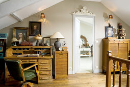 Old desk and American study furnishings in attic room