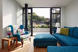 Blue sofa set in living room with open terrace doors