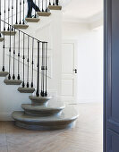 Classic foyer with elegant staircase and panelled walls