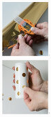 Hand-crafting vases: punching dots out of metallic adhesive foil and sticking on drinks can