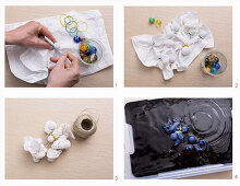Dying a place mat using the Shibori technique: fix glass marbles on fabric with rubber bands, wrap with cord and submerge in dye
