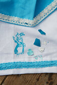 Tablecloth and napkin with lace trim and rabbit motif