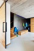 View through open sliding door in industrial-style foyer