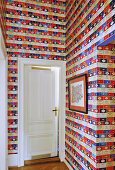 Colourful Penguin Library Wallpaper in hallway