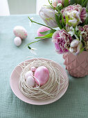 Easter nest and vase of flowers