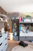 Grey bunk beds and chest of drawers in children's bedroom