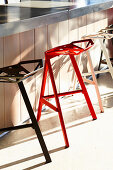 Designer aluminium bar stools at counter