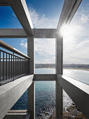 Balcony with metal balustrade in concrete frame, sea view