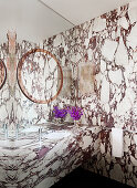 Bathroom with marble walls and marble vanity