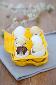 Cakes baked in egg shells in yellow-painted egg box
