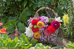 Basket of pompon dahlias, phlox and snapdragons