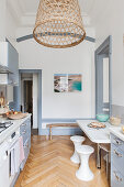 Pale grey and white kitchen in renovated period apartment