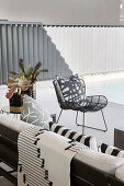 Black and white patterned textiles on sofa and armchair on terrace