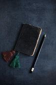 Vintage notebook with hand-made tassels as bookmarks