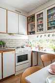 Ribbon window in cosy, white kitchen-dining room