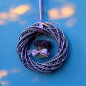Posy of lavender in centre of suspended wreath