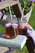 Summer drinks in screw-top jars with crocheted bows