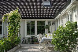 Set table in courtyard of Swedish house