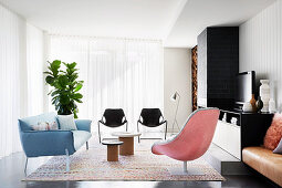 Lounge with designer armchairs, sofa and chairs