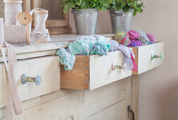 Old yarn reels used as drawer knobs on chest of drawers
