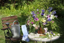 Summery bouquet on garden table