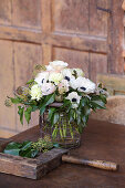Bouquet of anemones, carnations, ivy and ivy berries