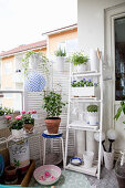 Balcony decorated in romantic shabby-chic style