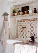 Mediterranean wall tiles above sink in country-house kitchen