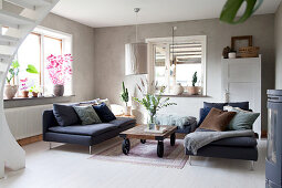 Dark blue sofa set in living room in muted shades