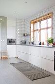 Modern, white fitted kitchen