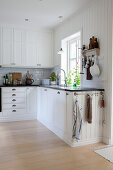 White country-house kitchen with panelled walls