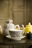 Teacup and teapot with knitted covers