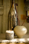 Votive candle lantern with knitted cover, vase and magnum bottle