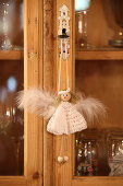 Handcrafted angel decoration with crocheted dress hung from cabinet key