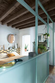 Half-open pale blue partition wall separating bedroom