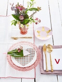 Leaf used as name tag on table set in pink