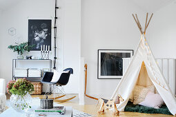 Child's teepee and rocking chair in classic living room