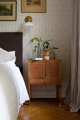 Old bedside cabinet in vintage-style bedroom