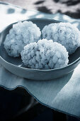 Crystallised pine cones in grey dish