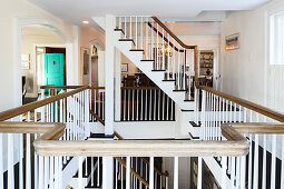 Staircase leading to various storeys with gallery landing