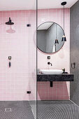 Pink bathroom with shower area and black details