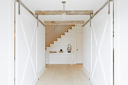 American, farmhouse-style sliding doors in hallway
