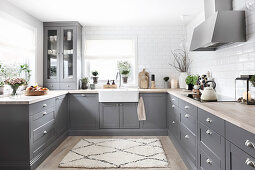 Country-house kitchen with grey panelled cabinets