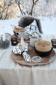 Set table in wintry garden