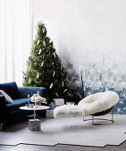 Christmas tree in corner of room with cozy seating