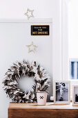 Feather wreath, framed photo, star decoration and sign in the bedroom