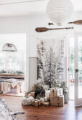 Wall hanging with snow-covered tree, wrapped Christmas presents in front of it