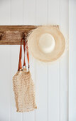 Hat and bag on rustic coat rack