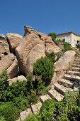 Steps leading between granite boulders